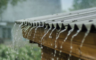 Rain flowing off a roof